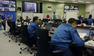 Workers monitor the Fukushima Daiichi Nuclear Power Plant from the Emergency Response Centre.