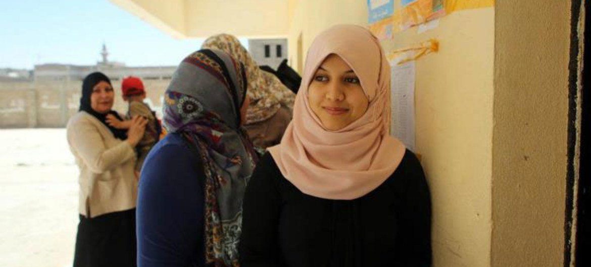 Libyan women queue up to vote on election day in July 2012.