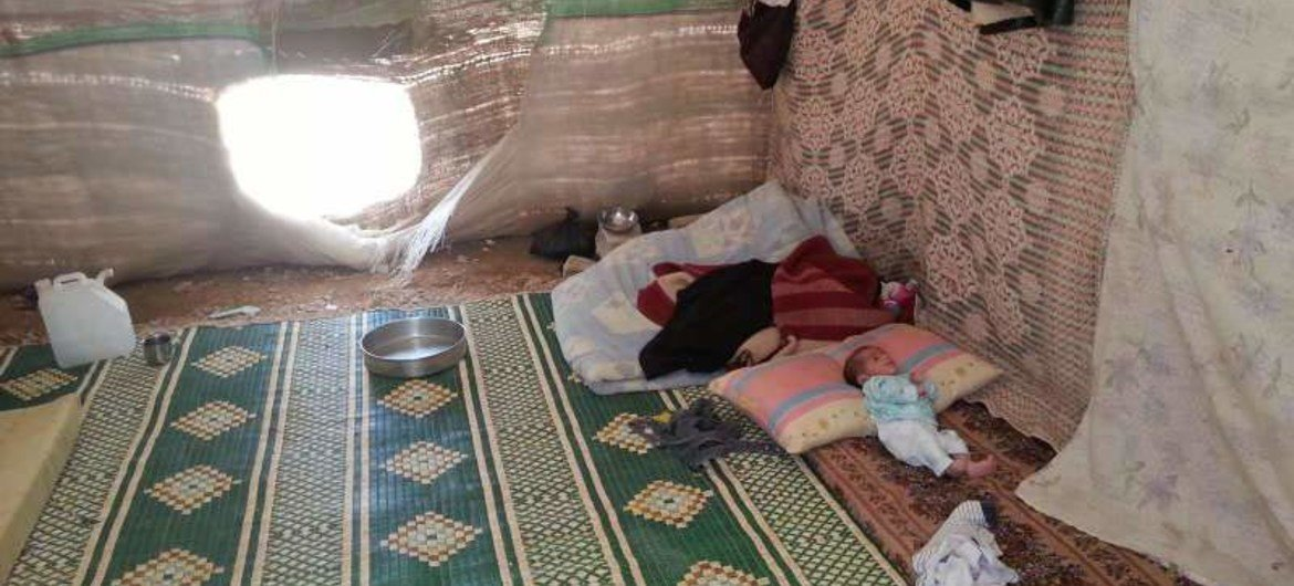 A baby gets some rest in one of the tents put up in Hasiya for the displaced Syrian families.