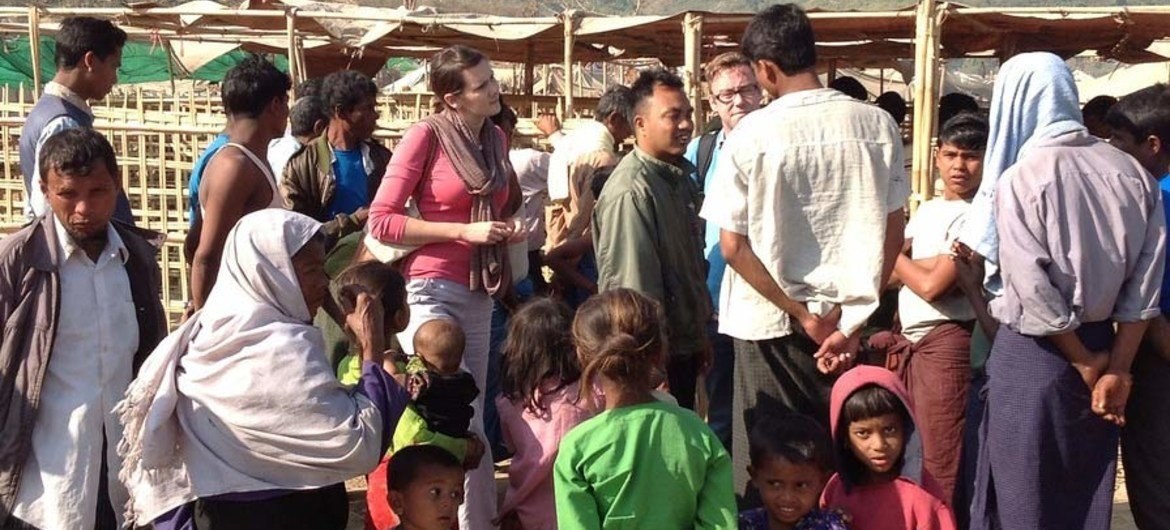 An assessment team talks to displaced people in Pauktaw camp in rural Rakhine, Myanmar, where more than 20,000 Rohingya live.