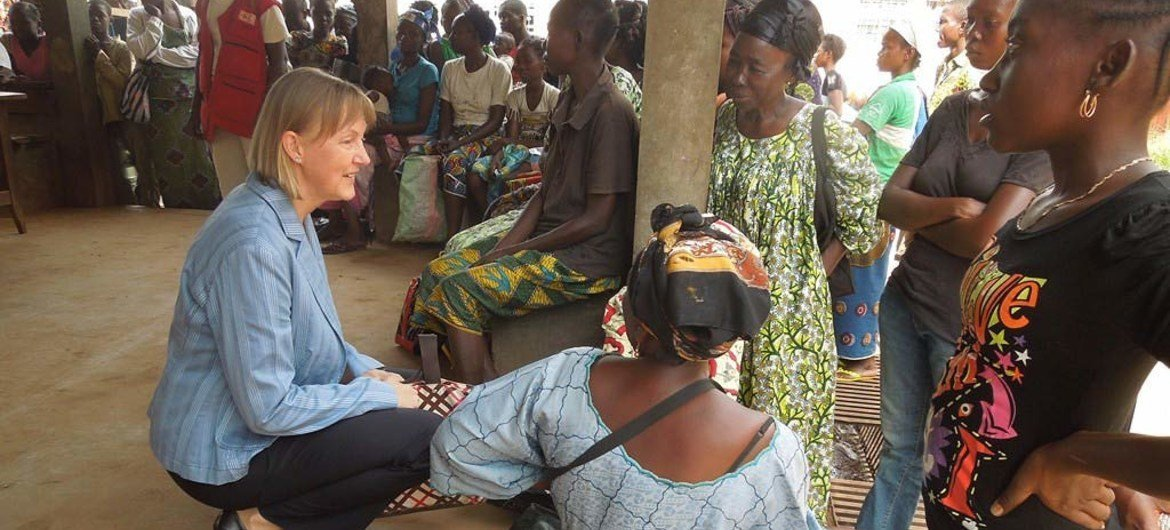 Humanitarian Coordinator for the Central African Republic, Kaarina Immonen (left), talks to people waiting to receive food assistance at the community hospital in Bangui.