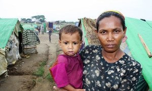 A Rohingya woman and her child at a makeshift camp outside Sittwe in Myanmar's western Rakhine State.