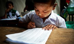 A child practices his writing during a kindergarten class.