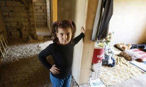 An eight-year-old Syrian refugee girl stands outside her room in the home of her Lebanese hosts in the Bekaa Valley.
