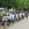 Pedicab drivers in Mindanao, the Philippines, support World Refugee Day. Many of them are internally displaced.
