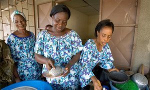 Ivorian widows run a small restaurant in Yopougon with the help of the non-governmental organization, Les Compagnes de Ruth.