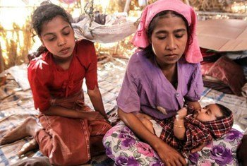 A displaced mother and her two children in Rakhine state. They originally came from the Pauktaw area.
