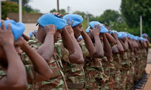 Forces of the UN Peacekeeping mission in Mali receive their blue berets in Bamako.