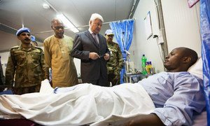 Hervé Ladsous, Under-Secretary-General for Peacekeeping Operations, pays a visit to an injured UNAMID peacekeeper hospitalized in Nyala, Darfur.