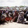 An archive photograph of Somali women waiting for UNHCR aid supplies at a settlement for the displaced in Mogadishu.