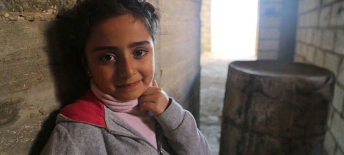 Pictured, a child takes shelter in an abandoned building in Al-Hassake city (Feb. '13). WFP/A. Etefa