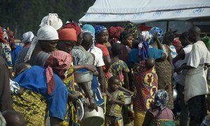 Congolese queue up for aid earlier in 2013 after fleeing the fighting for safety in Uganda.