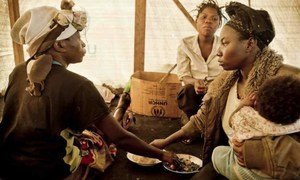 In eastern Democratic Republic of the Congo, these displaced women eat together in the tent they share. UNHCR is concerned about growing violence against women.