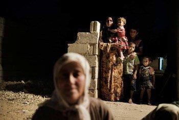 Femmes et enfants déplacés à Alep, en Syrie.