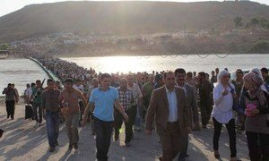 Thousands of people flowed from Syria across the Peshkhabour border crossing into Iraq's Dohuk Governorate.