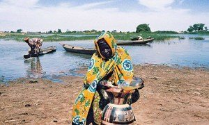 A villager takes extra precautions to keep her supply of water clean in Niger.