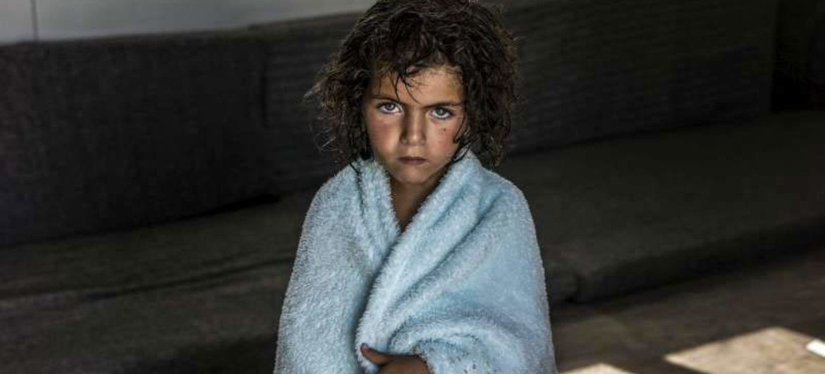 This girl sheltered in Zaatari refugee camp in Jordan is one of a million Syrian children who have become refugees because of the war.