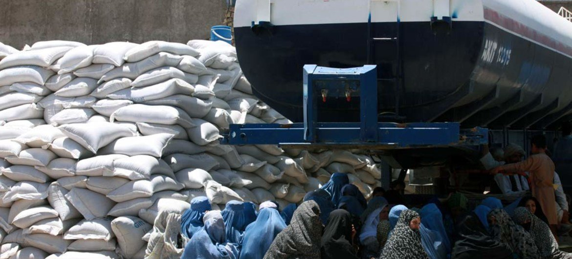 Women queue at a World Food Programme distribution point in Herat, Afghanistan.
