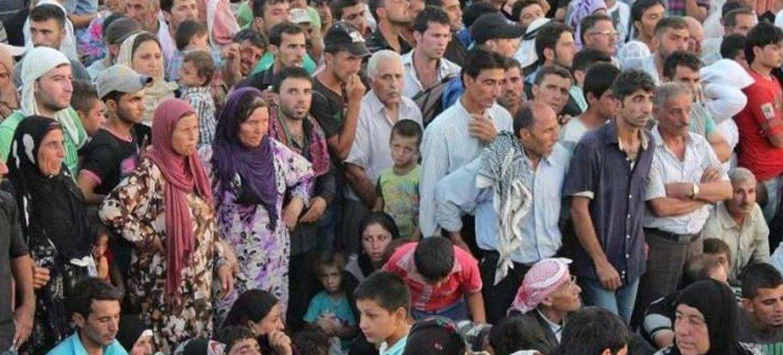 Syrians stream from their war-torn country into Iraq's Kurdistan region.