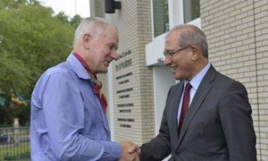 Ake Sellström (left), head of the UN Inspection Team to Syria, is greeted by OPCW Director-General Ahmet Üzümcü upon the team's return to The Hague on 31 August 2013.