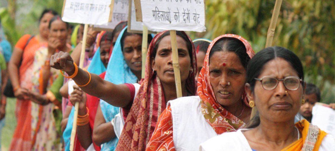 Women participating in a sweep campaign before local elections India's Bihar state.