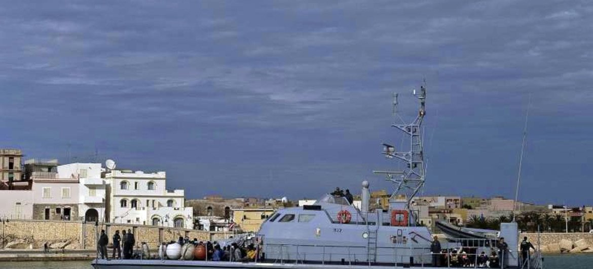 A customs boat enters a port in southern Italy after searching for boats carrying people hoping to reach Europe. More and more Syrians are taking sea routes to the continent.