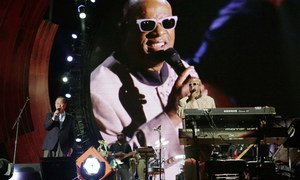 Secretary-General Ban Ki-moon on stage with UN Messenger of Peace Stevie Wonder at  the Global Citizen Festival at Central Park's Great Lawn.