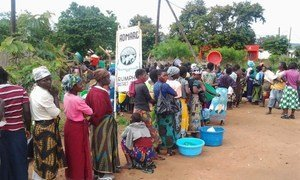 Consumers line up to buy scarce maize supplies at a market in Rumphi, northern Malawi.