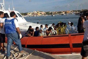 The Italian coastguard brings survivors of Thursday's tragedy to the harbour in Lampedusa. AMSA/UNHCR
