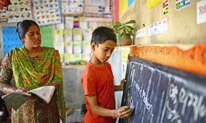 A teacher and student at a school in India.