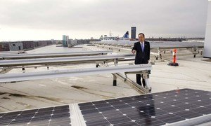 Secretary-General Ban Ki-moon tours the roof of UN City in Copenhagen, Denmark, which has been outfitted with wind turbines and solar panels.
