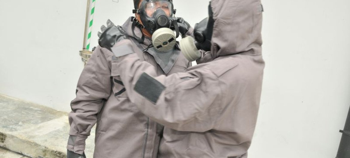 During an OPCW training course on emergency response to chemical incidents, participants learn to use protective gear.