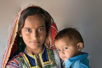 Couverture du rapport du FNUAP sur l'État de la population mondiale 2013.