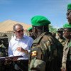 Deputy Secretary-General, Jan Eliasson (2nd left) chats with medical staff from the Ugandan contingent serving with the African Union Mission in Somalia (AMISOM) during a visit on 27 October 2013.