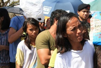 Residents of Tacloban, Philippines, queue for aid following Super Typhoon Haiyan (local name Yolanda).