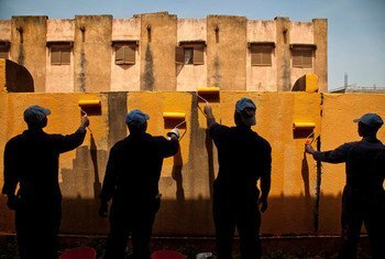 UN peacekeepers from Ghana Engineering Contingent paint the wall of a public school in Taliko, Bamako, Mali. Photo MINUSMA/Marco Dormino