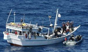 Boarding a pirate vessel off the coast of Somalia.