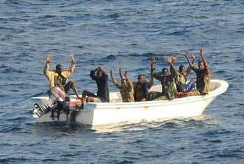 Suspected pirates wait for members of the counter-piracy operation to board their boat.
