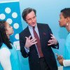 Peter Launsky-Tieffenthal, UN Under-Secretary-General for Communications and Public Information, holds a discussion with two young participants.
