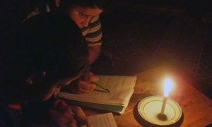 Yusri and his brother find it very exhausting to read by candle light.