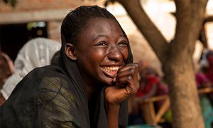 A girl laughs during a skit on the prevention of HIV, at a youth centre in Moundou, Chad.