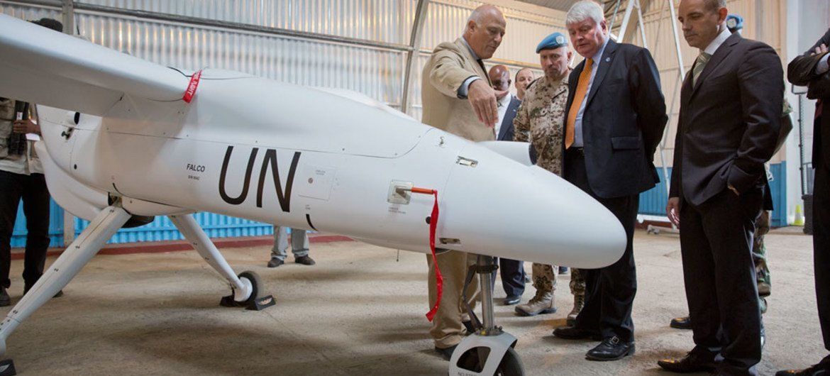 Head of Peacekeeping Operations Herve Ladsous (second right), inspects an Unmanned/Unarmed Aerial Vehicle (UAV) that will be used in eastern Democratic Republic of the Congo, during a ceremony in Goma. Photo: MONUSCO/Sylvain Liechti