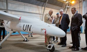 Head of Peacekeeping Operations Herve Ladsous (second right), inspects an Unmanned/Unarmed Aerial Vehicle (UAV) that will be used in eastern Democratic Republic of the Congo, during a ceremony in Goma.