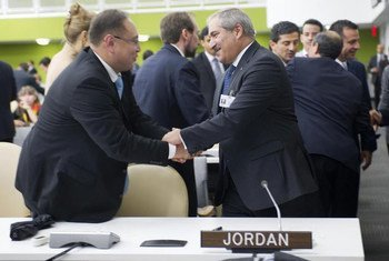 Foreign Minister Nasser Judeh of Jordan (right), is congratulated after his country was elected by the General Assembly as a non-permanent member of the Security Council.