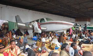 Displaced families in the Central African Republic (CAR) seek shelter at the Bangui airport fearing further attacks.