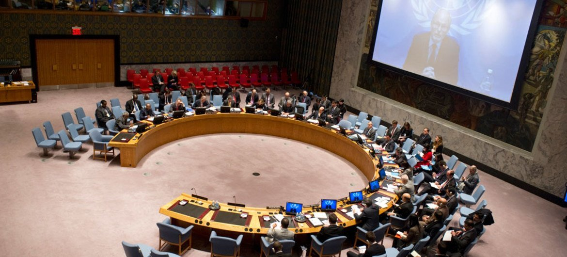 A wide view of the Security Council as it hears a briefing by Special Representative for Somalia, Nicholas Kay (on screen), via videolink.