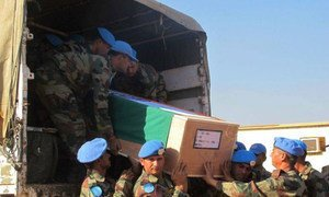 The remains of two UN peacekeepers from the Indian Battalion, killed in action on 19 December 2013 in Akobo Town, Jonglei State, South Sudan, arriving in Juba for a memorial ceremony.
