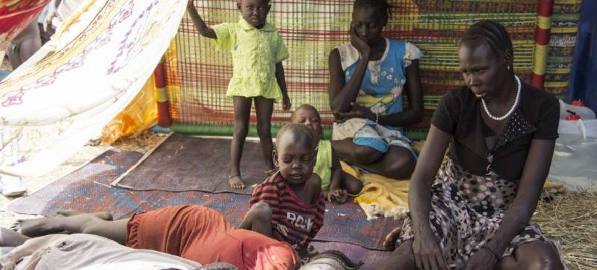 A family of South Sudanese civilians shelter at a UN base in Juba. UNHCR has been taking on increased responsibilities for the 57,000 civilians taking refuge in 10 UN compounds throughout the country.