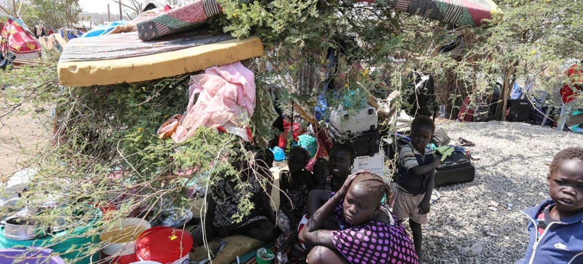 Displaced civilians with some of their only possessions take refuge at UN House.