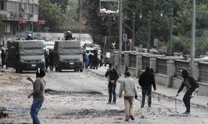 Angry protestors pelt policemen with stones in central Cairo on the second anniversary of the 2011 revolution that ousted long-time President Hosni Mubarak from power.